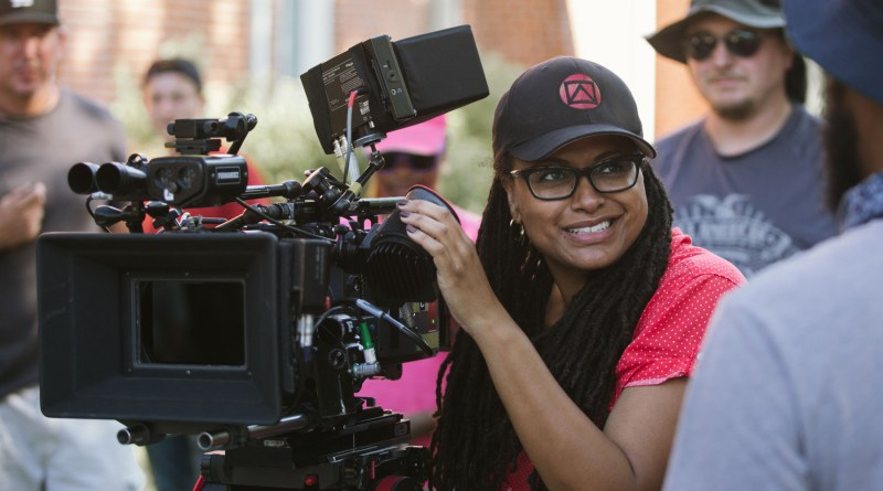 Director/Executive Producer Ava DuVernay (center) on the set of SELMA, from Paramount Pictures, Pathé, and Harpo Films. SEL-09411