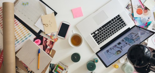 Overhead view of the desk of a modern businesswoman. Images on the desk are the property of Lumina Images and can be licensed at Stocksy.com.