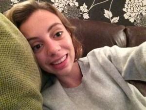 Me happy on my sofa