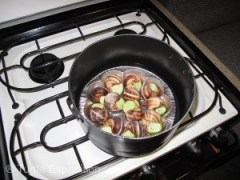 Fresh escargot simmering on the stove.