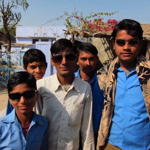 Village Boys Wanting to Chat and Try on Sunglasses