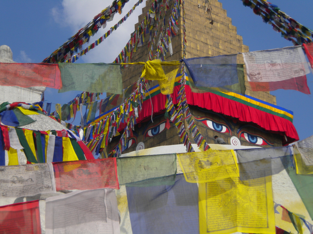 The eyes of Buddha look out over the Kathmandu Valley from all sides at the Boudhanath Stupa.