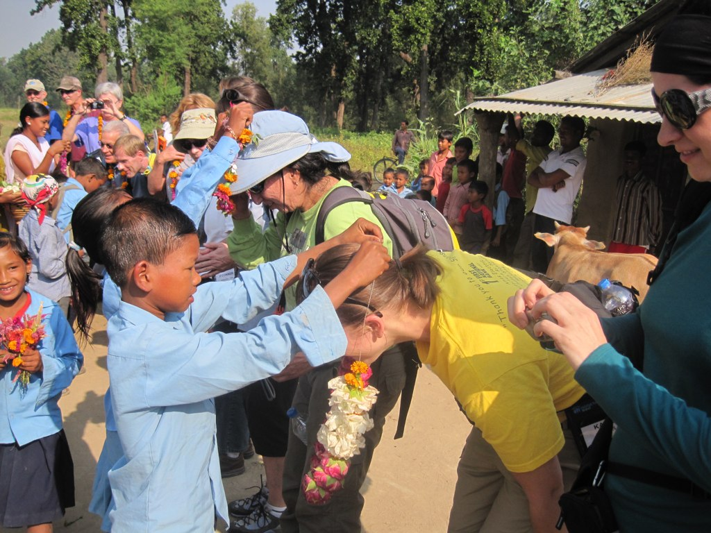 Local children greet Habitat volunteers near Tikapur in western Nepal.