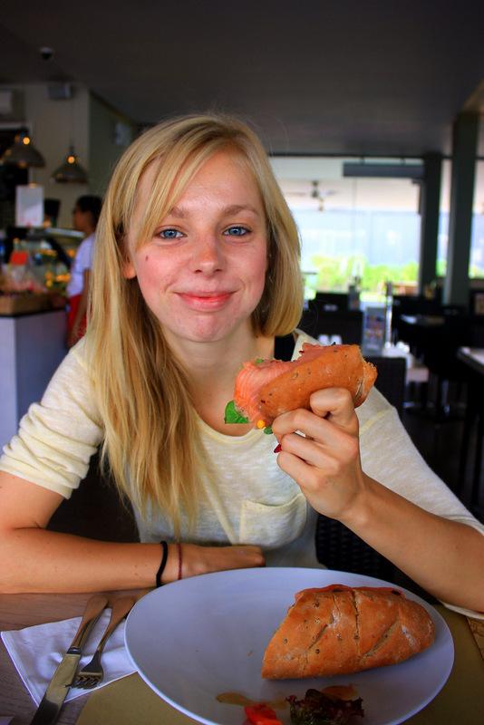 Enjoying salmon baguette in Bali