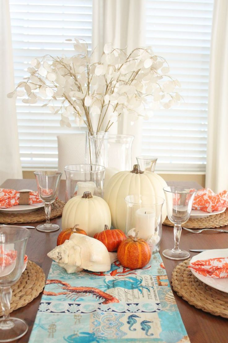coastal thanksgiving table decor beachy kitchen table Coastal Thanksgiving driftwood centerpiece Coastal Thanksgiving table decorated with pumpkins shells and beachy decor