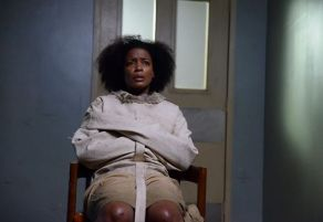 Abbie and Jenny's mother, Lori Mills (Aunjanue Ellis), in a straitjacket on Sleepy Hollow