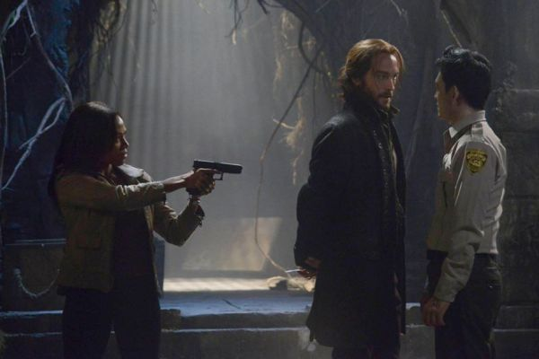 "Abbie Mills draws a gun on the undead Andy Brooks as Ichabod confronts him on the ""Midnight Ride"" episode of Sleepy Hollow"