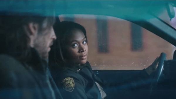 Abbie Mills (Nicole Beharie) escorts Ichabod Crane (Tom Mison) in a squad car on Sleepy Hollow
