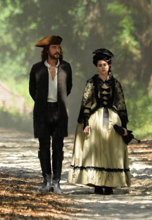 Ichabod strolls with Mary Wells on Sleepy Hollow.