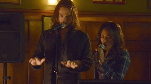 Ichabod Crane (Tom Mison) and Abbie Mills (Nicole Beharie) perform karaoke on Sleepy Hollow.
