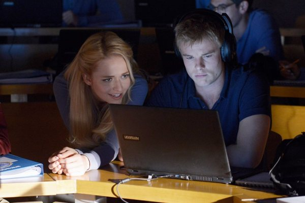 Shelby and Caleb look at a computer on Quantico