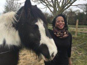 Elaine F. with a black and white horse.
