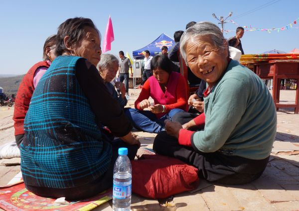 Old ladies gambling at the temple fair