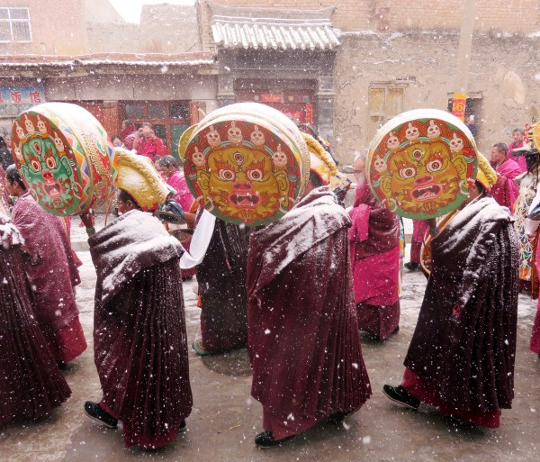 monks walking with drums (1)