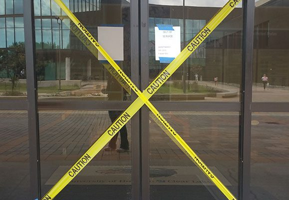 Photo: Sliding glass doors to Bayou Building from Alumni Plaza in disrepair. Photo by The Signal Reporter Amethyst Gonzalez.
