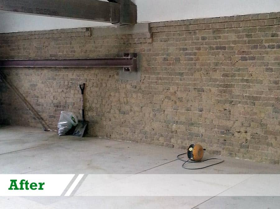 Sandblasting of brick wall completed by UK Performance Restoration, London UK.