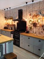 Rustic feeling kitchen with brickwork splashback