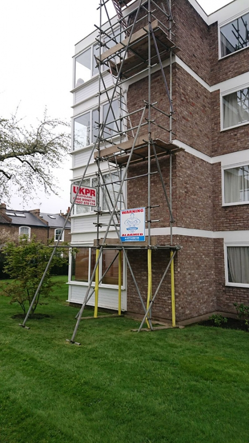Scaffolding towers on residential estate