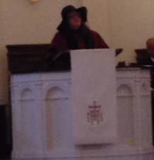 A really bad picture of Virginia preaching.
