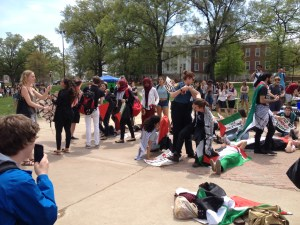 A group of about 22 people waving Palestinian flags appeared at Israel Fest last year. They yelled chants and lay down on the sidewalk until University Police ordered them to leave. Jacob Schaperow/Mitzpeh file.
