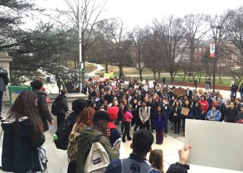 Students and community members protested President Donald Trump's recent immigration executive order in front of the Main Administration Building Wednesday. Jack Wisniewski/Mitzpeh.