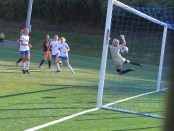 Jessi Vaverka (#14), Jessica Allen (#13), and Alex Bowen (#27) watch as Allen's shot goes past the Carson-Newman Goalie.