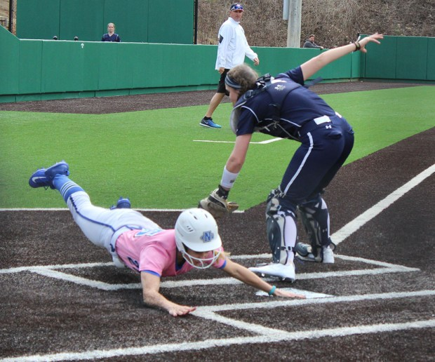 Outfielder Whitney Worth slides into home to score a run during Sunday's 8-0 victory against Shepherd University. (Photo by Jake Cantrell)