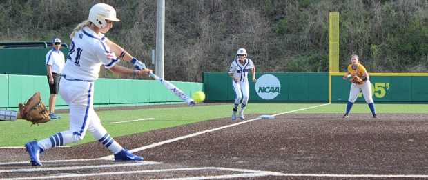 Sydney Sprague slaps a ball through the middle of the field, scoring two Nighthawks during the second game of a doubleheader sweep of Lander University on Sunday.