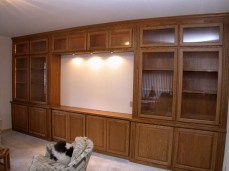 Red oak cabinetry with glass doors & LED illuminated interiors.