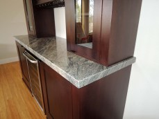 Mahogany storage cabinets with LED illumination and granite counter top