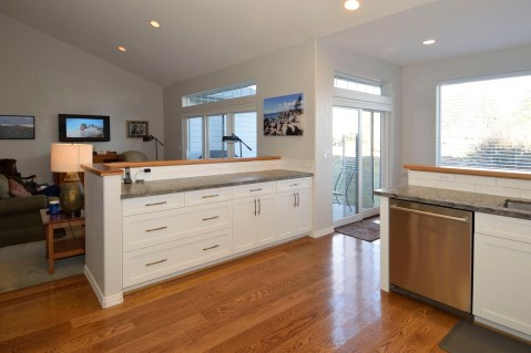 White cabinetry with Brushed Nickel Bow Pulls