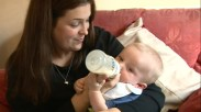 Mom feeds infant