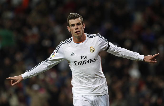 Real Madrid's Gareth Bale celebrates his goal against Real Valladolid during their Spanish First Division soccer match at Santiago Bernabeu stadium in Madrid November 30, 2013. REUTERS/Susana Vera (SPAIN - Tags: SPORT SOCCER) Picture Supplied by Action Images