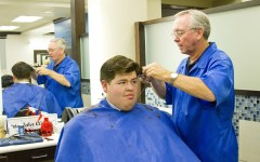 Jim Cochrin cuts Tim Bright's hair in the new Studio 1030 in the Wilkinson Center.