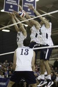 BYU attempts a block against Pepperdine on Thursday night. (Photo by Elliott Miller)
