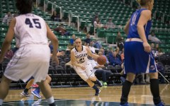 Lexi Eaton charges toward the basket in the game against Creighton. (Photo courtesy BYU Photo)