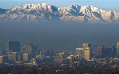 The Oquirrh Mountains as a an inversion blankets the Salt Lake Valley (AP Photo/The Salt Lake Tribune, Steve Griffin)
