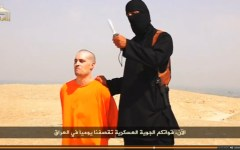 An unidentifed ISIS militant warns President Barack Obama that continued military action will result in military action before he beheads journalist James Foley. ISIS uses beheadings to incite fear. (Reuters)