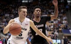 Kyle Collinsworth drives the ball against a UMass defender. (AP Photo)