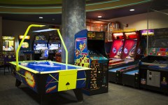 The BYU bowling and games center, located in the basement of the Wilkenson student center, is home to a wide variety of arcade games, such as skee ball, Pac-man and air hockey. Attendees include both students, alumni and visitors.(Eliana Lara)
