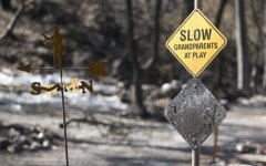 A scorched sign and homes remain on Thursday Sept. 17, 2015 in Anderson Springs, Calif. The Valley Fire that sped through Middletown and other parts of rural Lake County, less than 100 miles north of San Francisco, has continued to burn since Saturday despite a massive firefighting effort. (Paul Kitagaki Jr./The Sacramento Bee via AP) MAGS OUT; LOCAL TELEVISION OUT (KCRA3, KXTV10, KOVR13, KUVS19, KMAZ31, KTXL40); MANDATORY CREDIT (REV-SHARE) (ONLN OUT; IONLN OUT - MBI)