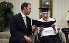 Catholic Central High School Principal Greg Deja, left, presents 97-year-old Margaret Thome Bekema with her honorary diploma at Stonebridge Manor on Thursday, Oct. 29, 2015 in Grand Rapids, Mich.. Bekema began her education at Catholic Central in 1932 but sacrificed completing her degree at that time to take care of her mother who had cancer and her younger siblings. (Emily Rose Bennett/The Grand Rapids Press via AP) ALL LOCAL TELEVISION OUT; LOCAL TELEVISION INTERNET OUT; MANDATORY CREDIT (Emily Rose Bennett | MLive.com)