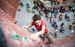 Devin Ashcraft reaches the top of a lead climbing wall at the Quarry. The indoor climbing industry grew by ten percent in 2015. (Ashcraft)