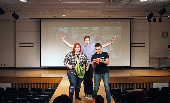 Sami Glass, Paul Dilyard and Ryan Phillips show off their creations on the runway at the University Innovation Fellows Kent State Regional Meetup. Photo by Laurie Moore.