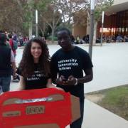 Alexandra Seda (left) & Francis Atore (right) with their DIY Tesla waiting to enter STVP's Future Fest with guest Elon Musk.