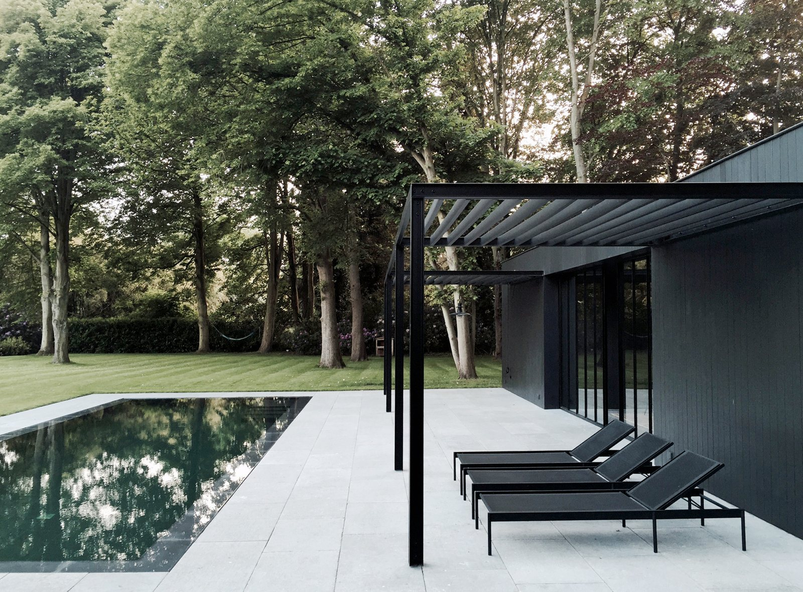 Pool Patio With Black Steel Pergola Cd Poolhouse By Marc