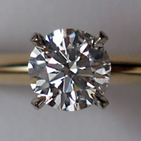 A round brilliant cut diamond set in a ring