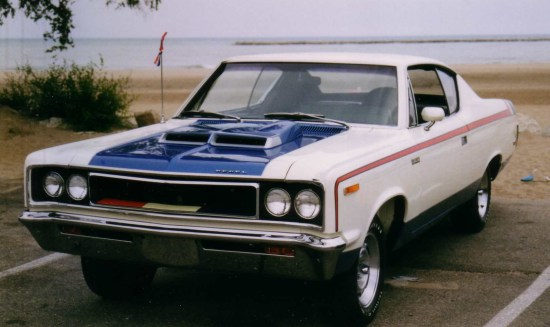 Description 1970 AMC The Machine 2-door muscle car in RWB trim by lake