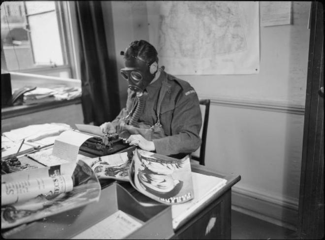 File:Air Raid Precautions in Britain- Staff of the Ministry of Information Wear Gas Masks To Work, London, England, 1941 D3745.jpg