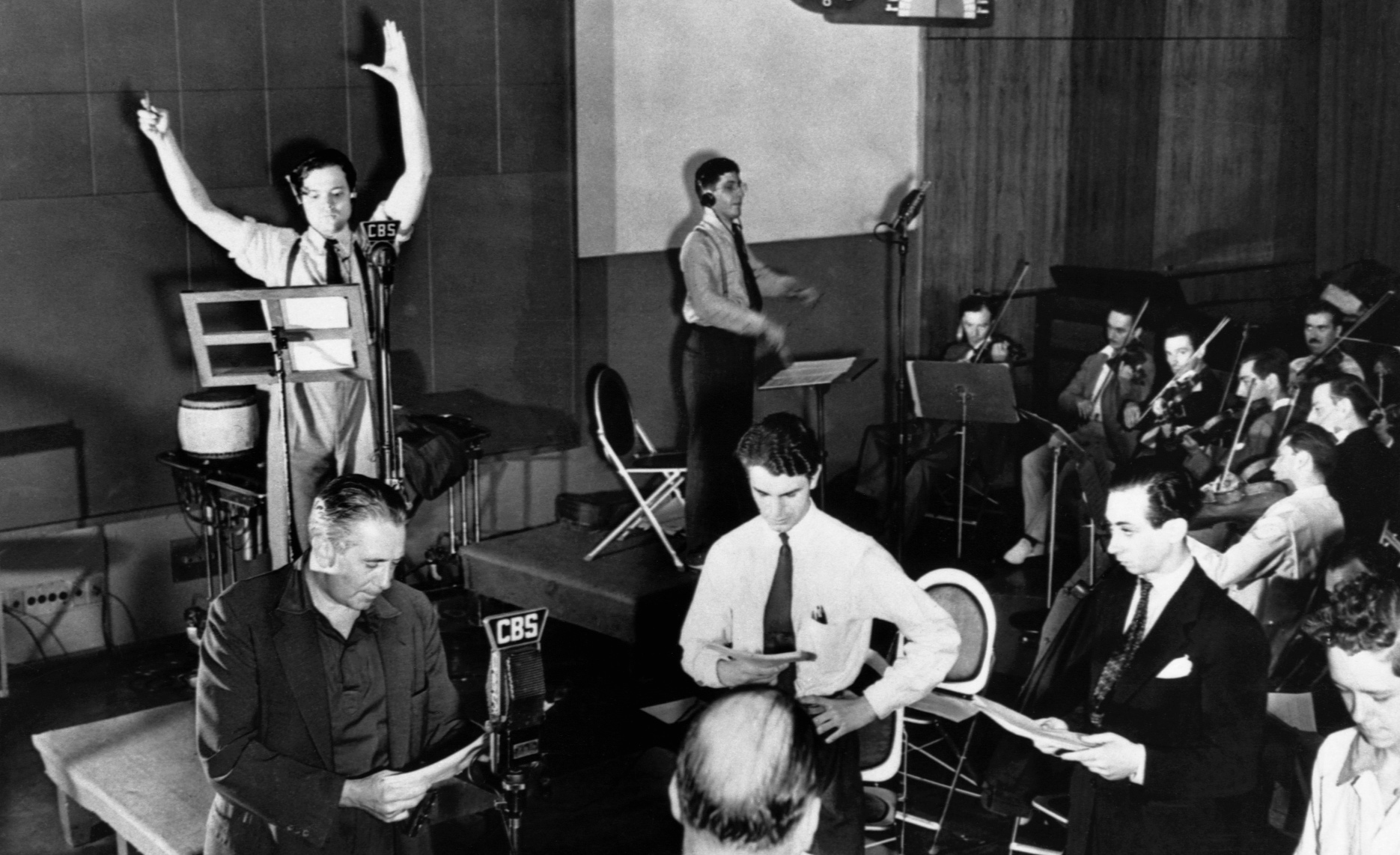 Orson welles arms upraised directing a rehearsal of cbs radio s the mercury theatre on the air 1938
